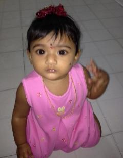 This undated photo provided by the Montgomery County District Attorney's Office shows Saanvi Venna. Authorities are searching for the 10-month-old girl, who disappeared after her grandmother was fatally beaten inside a suburban Philadelphia apartment. Police issued an Amber Alert for the Venna on Monday Oct. 22, 2012 following the discovery of her grandmother's body at the Marquis Apartments in King of Prussia, Pa. (AP Photo/Montgomery County District Attorney's Office)