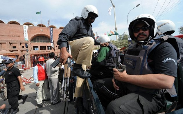 Policemen patrol after an attack by masked gunmen on the Sri Lankan cricket team bus in Lahore on March 3, 2009
