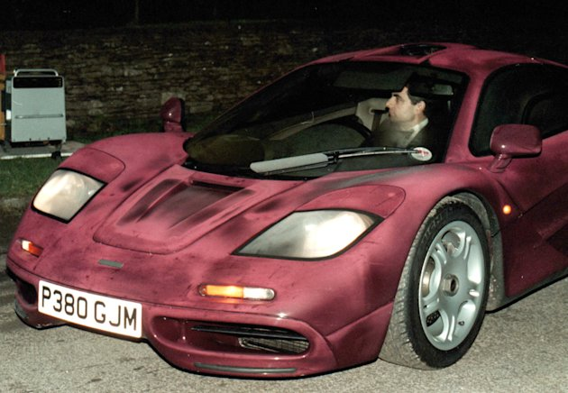 Photo dated Nov. 15 1998 of comedian Rowan Atkinson at the wheel of his McLaren F1 sports car. It was reported Friday Feb. 8 2013 that it took more than a year  and more than 900,000 pounds ($1,400,000)  to get his supercar up and running after a 2011 crash in which he badly injured a shoulder, but F1&#39;s now sell for around 3.5 million pounds. The car makes extensive use of carbon fiber and needed specialist care. The car insurance settlement is one of the largest in British history. (AP Photo/Barry Batchelor/PA) UNITED KINGDOM OUT NO SALES NO ARCHIVE