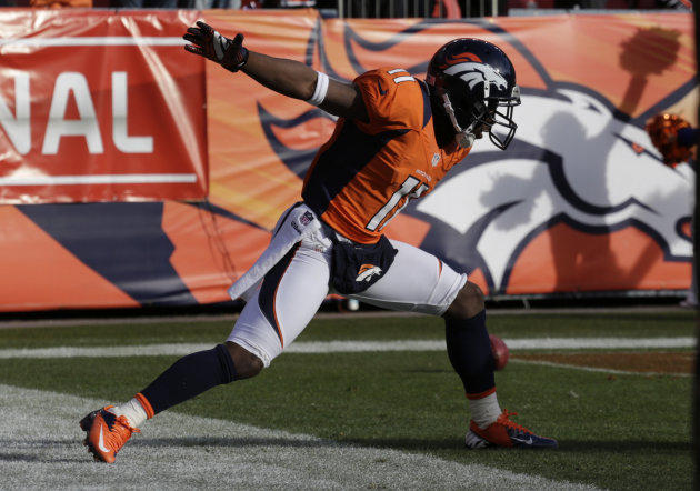 Denver Broncos wide receiver Trindon Holliday celebrates after running a punt return back 90 yards for a touchdown against the Baltimore Ravens in the first quarter of an AFC divisional playoff NFL fo
