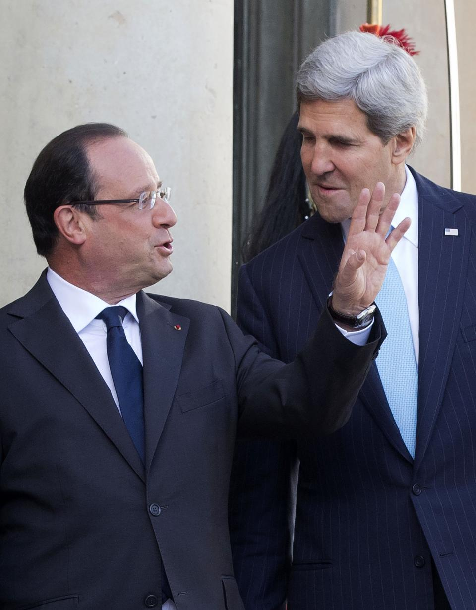 French President Francois Hollande, left, gestures as he talks to U.S. Secretary of State John Kerry, upon his arrival at the Elysee Palace in Paris, Monday, Sept. 16, 2013. (AP Photo/Michel Euler)