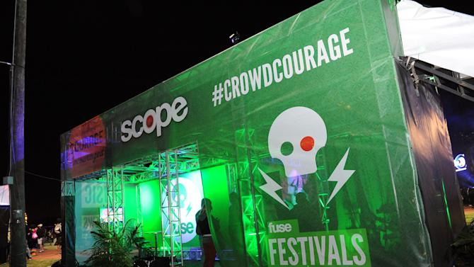 In this image distributed by SCOPE Mouthwash, fans enjoy glow sticks and sunglasses provided by SCOPE  at the VOODOO Music and Arts Experience, on Sunday, Oct. 28, 2012 in New Orleans. (Photo by Cheryl Gerber/Invision for SCOPE Mouthwash/AP Images)