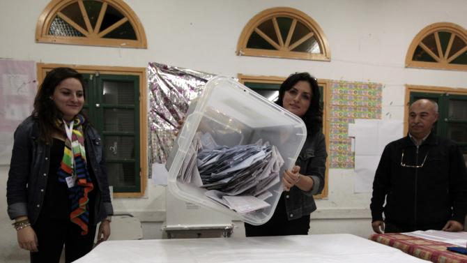 Election workers count ballots for Tunisia's presidential election in Sousse