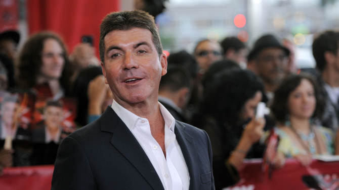 """Simon Cowell, executive producer and a judge on """"The X Factor,"""" poses at a world premiere screening event for the new television series, Wednesday, Sept. 14, 2011, in Los Angeles. The competition series gives viewers the opportunity to choose the next breakout music star or group. (AP Photo/Chris Pizzello)"""