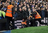 A steward lays injured following Manchester United's third goal at Stamford Bridge