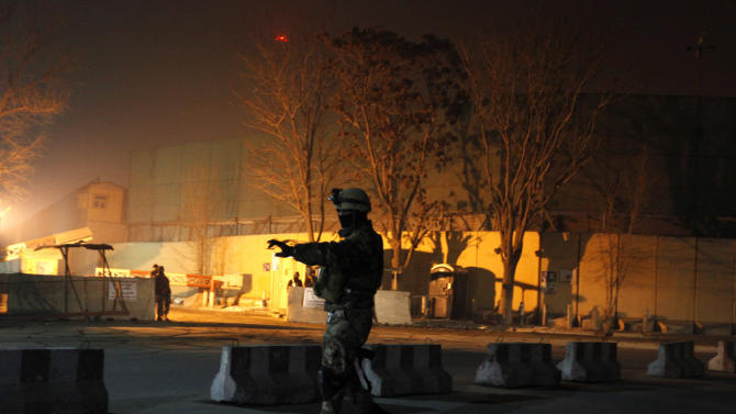 An Afghan security personnel keeps watch near the site of an explosion in Kabul