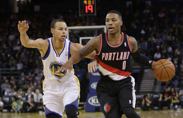 Portland Trail Blazers' Damian Lillard (0) dribbles next to Golden State Warriors' Stephen Curry during the first half of an NBA preseason basketball game on Thursday, Oct. 24, 2013, in Oakland, Calif