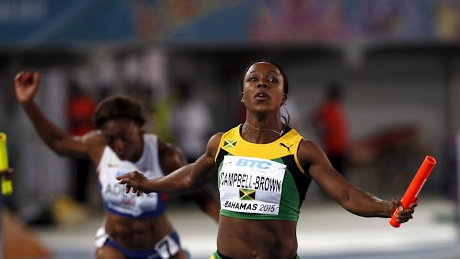 Jamaica's Veronica Campbell-Brown crosses the finish line as Jamaica wins the women's 4x4100 relay race at the IAAF World Relays Championships in Nassau