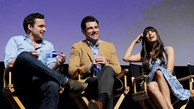 """Actors Jake Johnson (left), Max Greenfield (center) and Hannah Simone participate in FOX's """"New Girl"""" screening and Q&A at the Academy of Television Arts & Sciences' Leonard H. Goldenson Theater on Tuesday, April 30, 2013 in North Hollywood, California. (Photo by Frank Micelotta/Invision for FOX/AP Images)"""