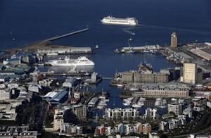 Cruise liner MSC Symphony sails past Cape Town's popular Waterfront district