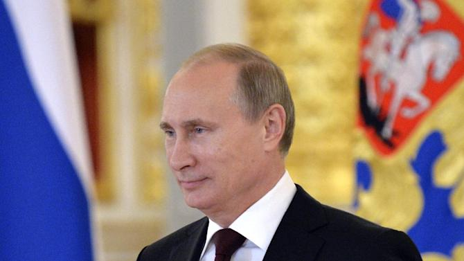 "FILE - In this June 27, 2014, file photo, Russian President Vladimir Putin attends a ceremony of presentation of credentials by foreign ambassadors in the Grand Kremlin Palace in Moscow. In a statement published on the Kremlin website on Friday, July 4, 2014, Putin said ""regardless of difficulties and disagreements"" he hoped that Russia and the U.S. could ""successfully develop relations on pragmatic and equal grounds."" Relations between Russia and the U.S. have deteriorated as the two countries have struggled to find common ground in Ukraine. (AP Photo/Yuri Kadobnov, Pool, File)"