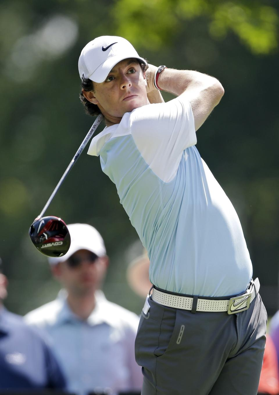 Rory McElroy, from Northern Ireland, watches his tee shot on the ninth hole during the first round of the Bridgestone Invitational golf tournament on Thursday, Aug. 1, 2013, at Firestone Country Club in Akron, Ohio. (AP Photo/Mark Duncan)