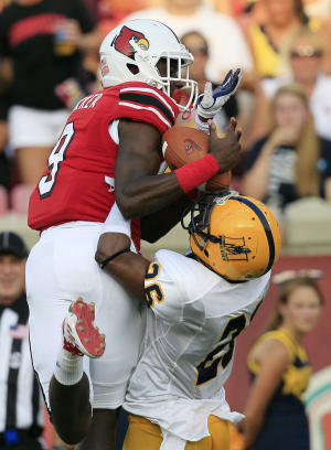 Louisville's DeVante Parker catches a touchdown pass over Murray State 's T.J. Denson during the first half of an NCAA college football game Thursday, Sept. 1, 2011, in Louisville, Ky. (AP Photo/Ed Reinke)
