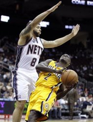 Indiana Pacers' Darren Collison (2) drives against New Jersey Nets' Deron Williams (8) in the first quarter of an NBA basketball game on Wednesday, March 28, 2012, in Newark, N.J. (AP Photo/Julio Cortez)