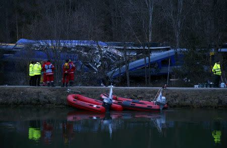 Members of emergency services at the site of two crashed trains near Bad Aibling in southwestern Germany