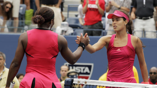 Ana Ivanovic of Serbia, right, shakes hands with Serena Williams during the U.S. Open tennis tournament in New York, Monday, Sept. 5, 2011. (AP Photo/Charlie Riedel)