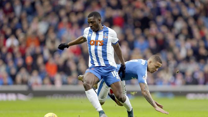 Rangers' James Tavernier (R) in action with Kilmarnock's Temitope Obadeyi