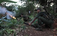 Kachin rebels fire rockets from an outpost on the Laja Yang frontline, on September 22, 2012. Kachin rebels cast doubt on Saturday over a Myanmar government pledge to end a military offensive after weeks of intense fighting that sparked international concern amid reports of fresh shelling