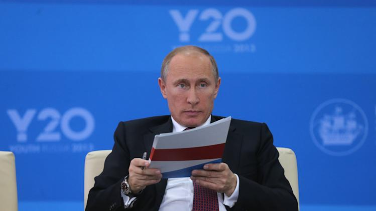 Russian President Vladimir Putin attends a meeting with representatives of the G20 Youth Summit at the economic forum in St. Petersburg, Russia, Thursday, June 20, 2013. (AP Photo/Anatoly Maltsev, Pool)