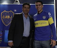 Angelici junto a Magalln