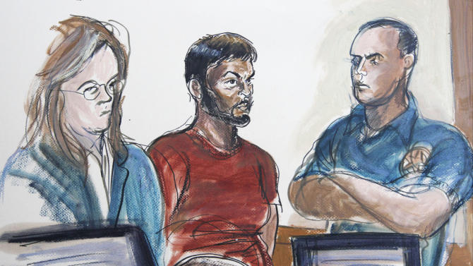 FILE - In this courtroom file image of Oct. 17, 2012, Quazi Mohammad Rezwanul Ahsan Nafis, 21, center, and his attorney Heidi Cesare, left, are shown in Brooklyn Federal Court in New York. The Bangladesh native accused of trying to blow up the Federal Reserve Bank in New York with what he thought was a 1,000-pound car bomb pleaded guilty Thursday, Feb. 7, 2013 to terrorism charges stemming from an FBI sting. (AP Photo/Elizabeth Williams, File)