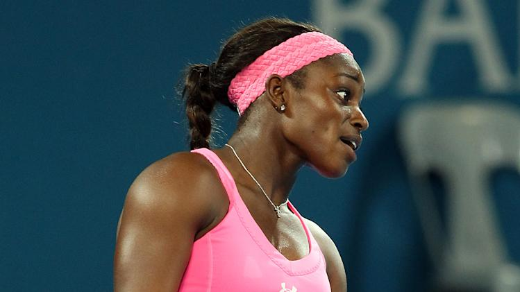 Sloane Stephens of the U.S. reacts during her quarter final match against Serena Williams of the U.S. during the Brisbane International tennis tournament in Brisbane, Australia, Thursday, Jan 3, 2013.  (AP Photo/Tertius Pickard).