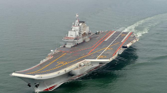 FILE - In this May 2012 file photo provided by China's Xinhua News Agency, Chinese aircraft carrier Liaoning cruises for a test in the sea. As President Barack Obama tours Southeast Asia to push his year-old pivot to the Pacific policy, the big question on everybody's mind is how much of a role Washington, with its mighty military and immense diplomatic clout, can play in keeping the Pacific peaceful. (AP Photo/Xinhua, Li Tang, File) NO SALES