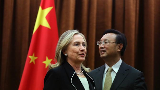U.S. Secretary of State Hillary Rodham Clinton, left, meets with Chinese Foreign Minister Yang Jiechi, at the Ministry of Foreign Affairs in Beijing Tuesday, Sept. 4, 2012.  Clinton is in Beijing to press Chinese authorities to agree to peacefully resolve disputes with their smaller neighbors over competing territorial claims in the South China Sea. (AP Photo/Feng Li, Pool)
