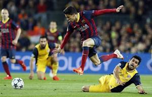 Atletico Madrid's Costa and Barcelona's Bartra fight for the ball during their Champions League quarter-final first leg soccer match against Atletico Madrid in Barcelona
