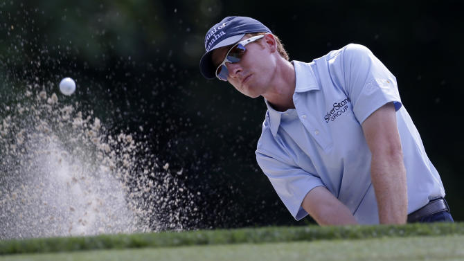 Roberto Castro hits out of a bunker on the 12th hole during the second round of the AT&T National golf tournament at Congressional Country Club, Friday, June 28, 2013, in Bethesda, Md. (AP Photo/Patrick Semansky)