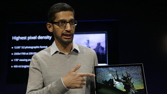 Sundar Pichai, Google's senior vice president of Chrome and apps, discusses the Google Chromebook Pixel laptop computer at an announcement in San Francisco, Thursday, Feb. 21, 2013. Google is adding a new touch to its line of Chrome laptops in an attempt to outshine personal computers running on software made by rivals Microsoft and Apple.  (AP Photo/Jeff Chiu)