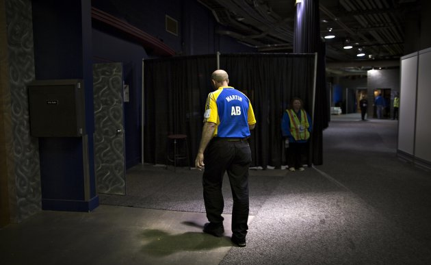 Alberta skip Martin heads back to dressing room after being defeated by New Brunswick during the Canadian Men's Curling Championships in Edmonton
