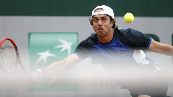Paolo Lorenzi of Italy plays a shot to Gilles Muller of Luxembourg during their men's singles match at the French Open tennis tournament at the Roland Garros stadium in Paris