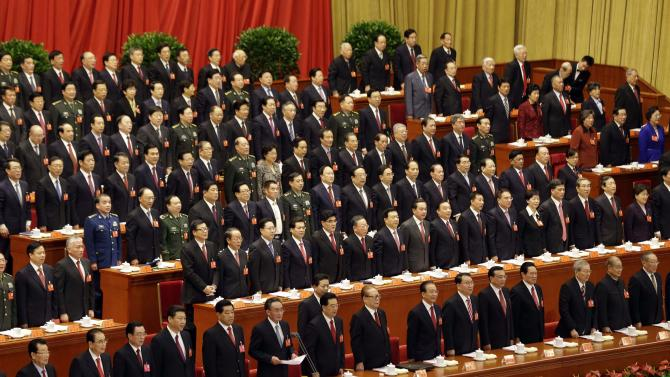 Communist leaders stand before the national anthem during the opening session of the 18th Communist Party Congress at the Great Hall of the People in Beijing Thursday, Nov. 8, 2012. China's ruling Communist Party opened a congress Thursday to usher in a new group of younger leaders faced with the challenging tasks of righting a flagging economy and meeting public calls for better government. (AP Photo/Lee Jin-man)