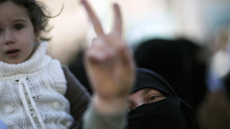 A woman displays a victory sign during an anti-government demonstration in Idlib, north Syria, Friday, March 9, 2012. (AP Photo/Rodrigo Abd)