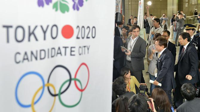 Tokyo Gov. Naoki Inose, center, is surrounded by reporters upon his arrival at Tokyo Metropolitan Government Office in Tokyo Tuesday, April 30, 2013. Inose apologized on Tuesday for criticizing Istanbul, a rival candidate for the 2020 Olympics. Inose, also chairman of the bid committee, was quoted in the New York Times last weekend suggesting Istanbul was less developed and less equipped to host the games than the Japanese capital. (AP Photo/Kyodo News) JAPAN OUT, MANDATORY CREDIT