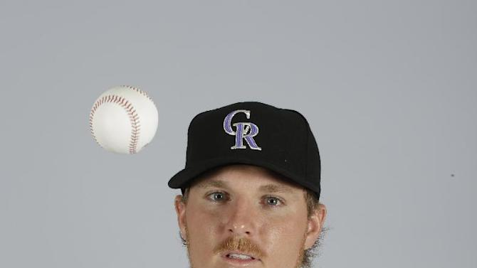 This is a 2015 photo of Jonathan Gray of the Colorado Rockies baseball team. This image reflects the Rockies active roster as of March 1, 2015, when this image was taken. (AP Photo/Darron Cummings)