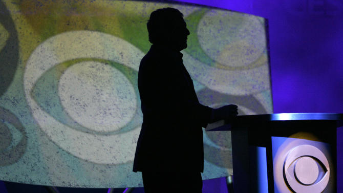 FILE - In this Jan. 9, 2007, file photo, Leslie Moonves, president and CEO of CBS Corp., is silhouetted while watching a video presentation during his keynote speech at the Consumer Electronics Show in Las Vegas . Thanks to football and a slate of robust comedy and drama shows, CBS clobbered its prime-time competition for the first full week of 2014. (AP Photo/Jae C. Hong, file)