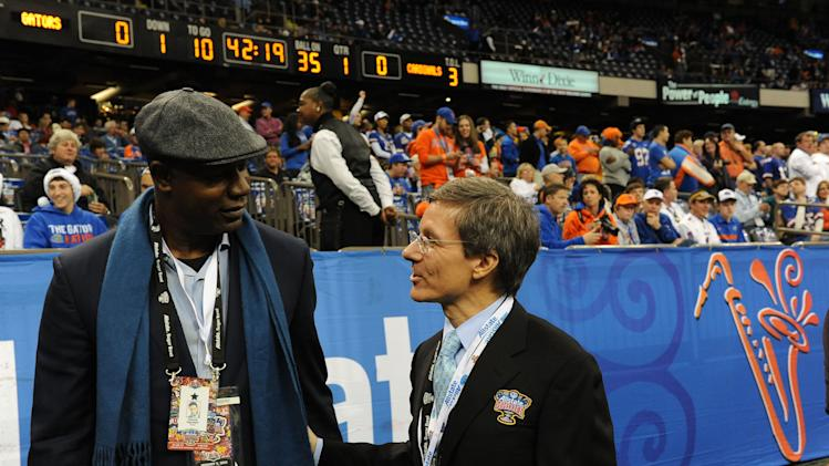 IMAGE DISTRIBUTED FOR ALLSTATE- Actor Dennis Haysbert (left) and Allstate Insurance CEO Tom Wilson (right) converse on the sideline before the 2013 Allstate Sugar Bowl in New Orleans on Jan. 2, 2013. (Cheryl Gerber/AP Images for Allstate)