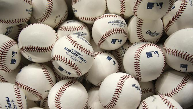 Practice baseballs are shown before the start of a baseball game between the Miami Marlins and the San Francisco Giants, Wednesday, July 1, 2015, in Miami. (AP Photo/Wilfredo Lee)