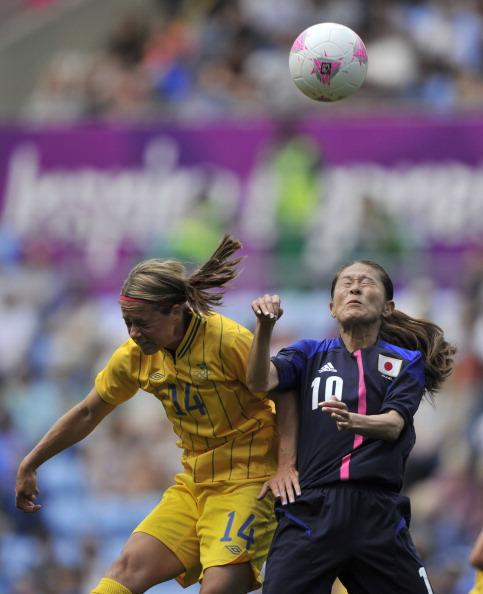 Homare Sawa of Japan and Johanna Almgren of Sweden during the Women's Football first round Group F Match between Japan and Sweden on Day 1 of the London 2012 Olympic Games at City of Coventry Stadium on July 28, 2012 in Coventry, England. (Photo by Francis Bompard/Getty Images)