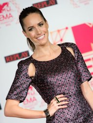 British TV presenter Louise Roe poses during a photo call at the Frankfurt town hall, in Frankfurt Germany Saturday Nov. 10, 2012. She will host the Red Carpet-Show at Sunday's MTV European Music Awards 2012 celebrated in Frankfurt. (AP Photo/dapd/Thomas Lohnes)