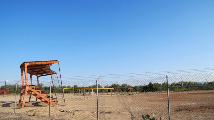 This Oct. 10, 2012 photo shows a ball field, the alleged site where Heriberto Lazcano, a founder and top leader of the Zetas drug cartel, was killed in Mexico's Coahuila state. Despite the crowd, nobody is willing to admit they were there the afternoon of Oct. 7 or saw the shootout just outside the ball field in the heart of Coahuila state, the alleged site where Mexican marines  gunned down Lazcano,  the biggest kingpin netted so far in Mexico's President Felipe Calderon's six-year assault on organized crime. (AP Photo/Olga R. Rodriguez)