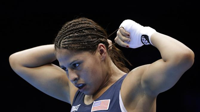 United States' Marlen Esparza leaves the ring after defeating Venezuela's Karlha Magliocco in a women's flyweight 51-kg quarterfinal boxing match at the 2012 Summer Olympics, Monday, Aug. 6, 2012, in London. (AP Photo/Patrick Semansky)