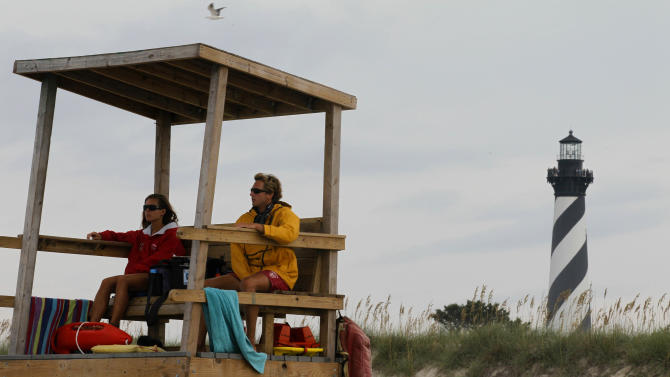 "FILE - In this Aug. 24, 2011 file photo, lifeguards keep watch over the beach along the Cape Hatteras National Seashore in Buxton, N.C.  Cape Hatteras   is number ten on the 2012 list of Top 10 Beaches produced annually by coastal expert Stephen P. Leatherman, also known as ""Dr. Beach,"" director of Florida International University's Laboratory for Coastal Research. (AP Photo/Gerry Broome, file)"