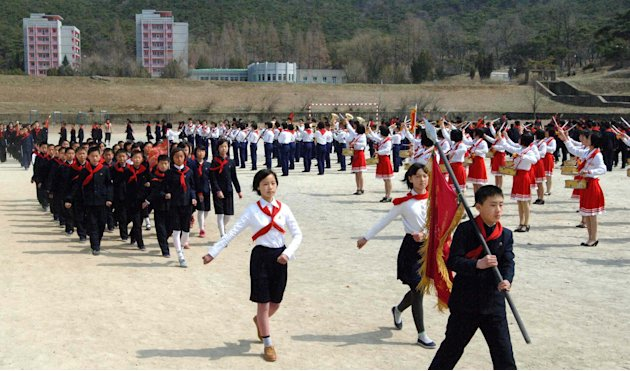 Students march at a camping site in Pyongyang
