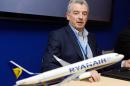 Ryanair chief executive officer Michael O'Leahry poses with a Boeing scale-model on June 19, 2013 before signing a new contract for buying 175 Boeing 737-8 at Le Bourget airport, near Paris, during the 50th International Paris Air show