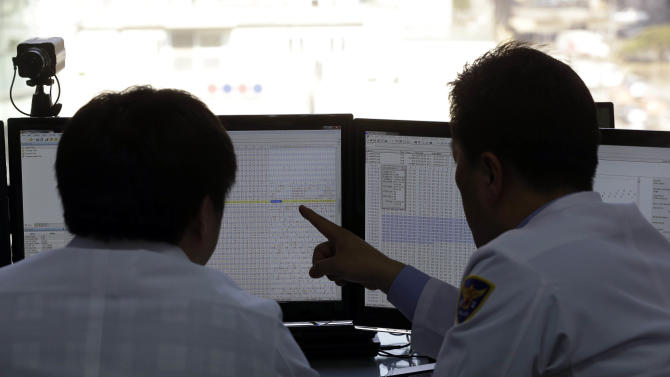 Two South Korean computer researchers look at the computer monitors as they check the shutdown computer servers of Korean Broadcasting System (KBS) at Cyber Terror Response Center at National Police Agency in Seoul, South Korea, Thursday, March 21, 2013. A Chinese Internet address was the source of a cyberattack on one company hit in a massive network shutdown that affected 32,000 computers at six banks and media companies in South Korea, initial findings indicated Thursday. (AP Photo/Lee Jin-man)