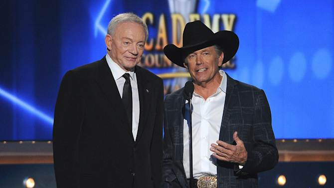 Jerry Jones, left, and George Strait speak on stage at the 49th annual Academy of Country Music Awards at the MGM Grand Garden Arena on Sunday, April 6, 2014, in Las Vegas. (Photo by Chris Pizzello/Invision/AP)