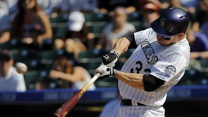 Colorado Rockies' Justin Morneau hits a single against the Arizona Diamondbacks during the first inning of a baseball game Saturday, Sept. 20, 2014, in Denver. (AP Photo/Jack Dempsey)